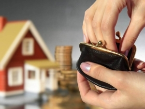 Каков порядок налогообложения налогом на имущество недвижимости, находящейся в собственности несовершеннолетних граждан?